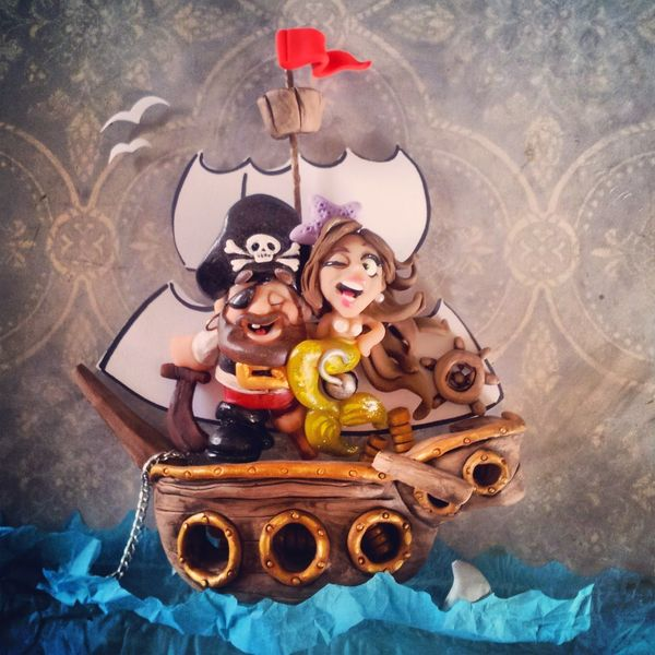 Pirate and mermaid sculpture by Christina Patterson from idocaketoppersDOTcom